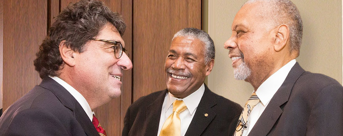 Photo of Perry Wallace and Godfrey Dillard with Chancellor Nick Zeppos.