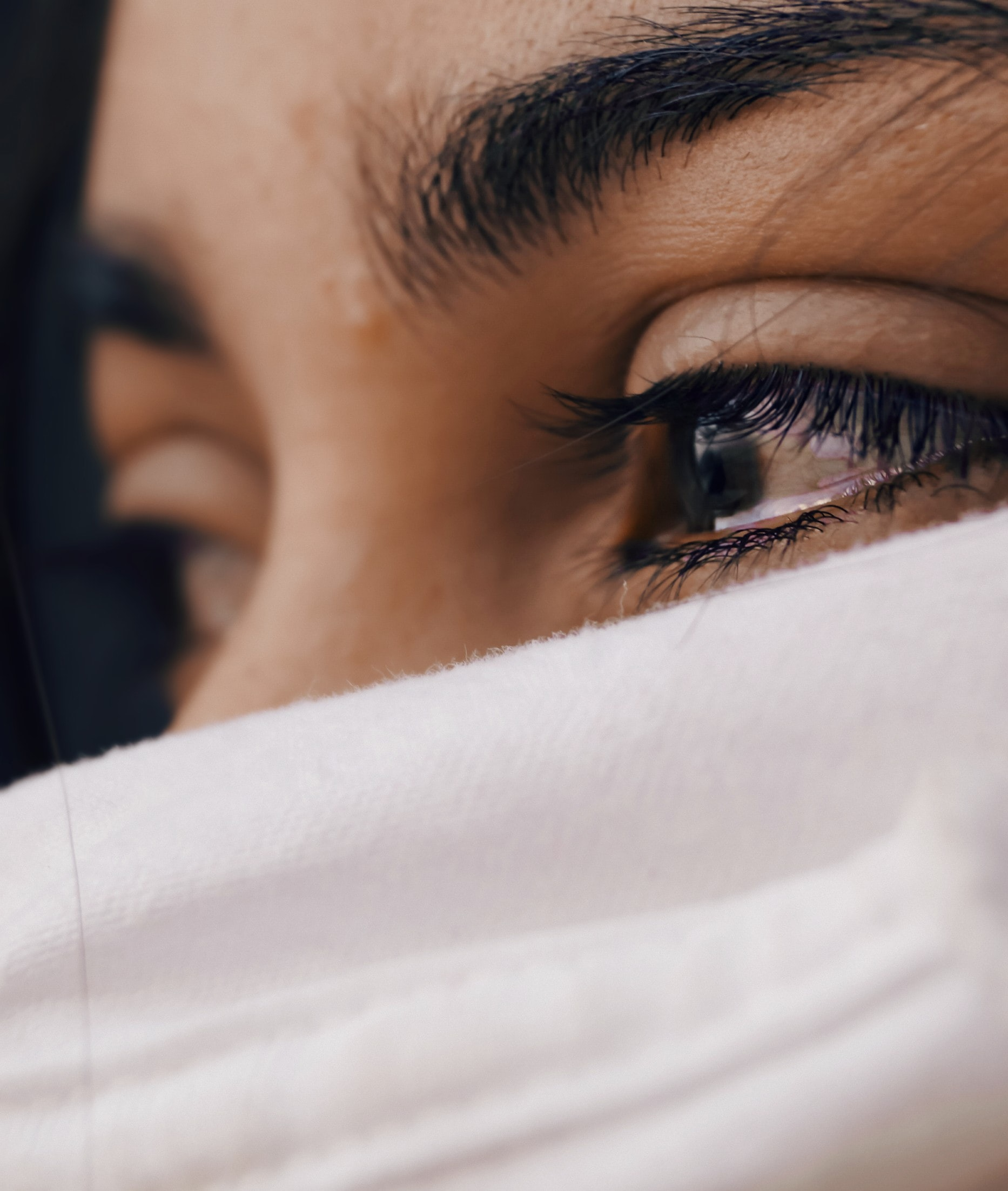 a close up of image of woman with tears in her eyes