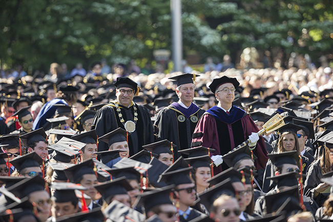Chancellor Nicholas Zeppos walks in for Commencement ceremony on Alumni Lawn.