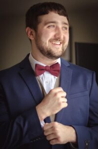 Person wearing suit and tie smiling