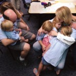 Jada and Kevin comfort all of their five children in a group hug before Jada and Shafer go to prepare for surgery.