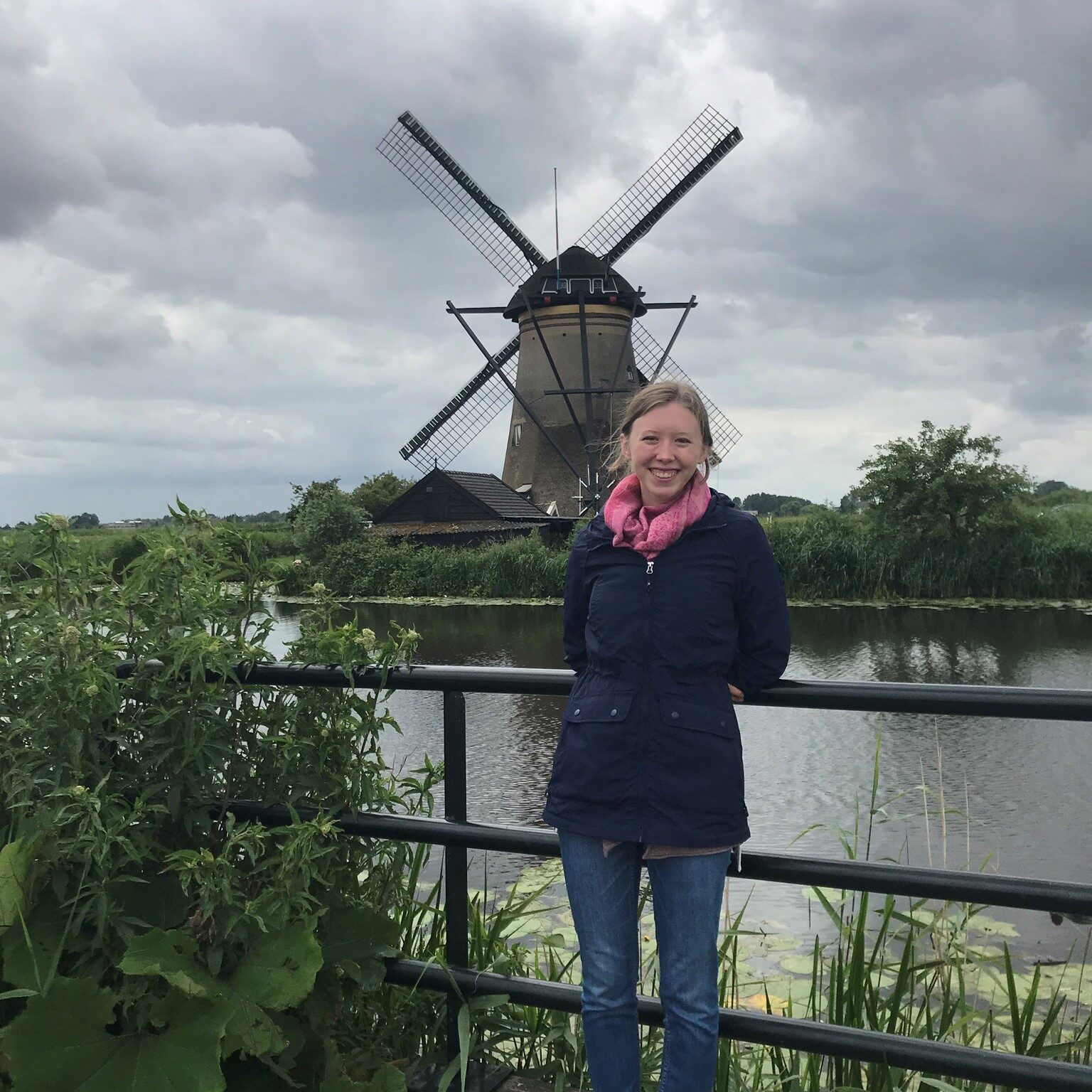 Emma Hart in front of a windmill in the Netherlands