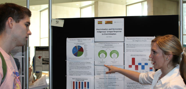 Vanderbilt senior Ariel Helms presents her research at the Undergraduate Research Fair