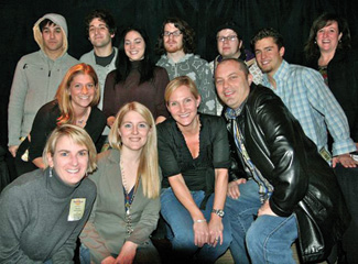 MTV's Lovinger (in leather coat) and industry representatives with the rock group Fall Out Boy.