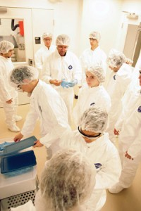 Students don bunny suits to enter the clean room.