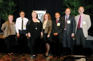 From left, Dean Carolyn Dever congratulates William P. Caferro, Lynn Enterline, Jane G. Landers, William Luis, James Patton and Carl Johnson, who were celebrated at a ceremony in May.