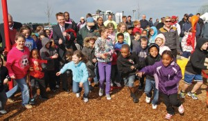 The ribbon cutting for a revitalized park delighted children and mayor alike.