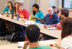 McKibben and students discussing how to change things globally by acting locally.