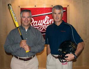 John Parish (left) holding a Worth Sporting Goods bat, and his brother Robert, holding a football helmet Rawlings designed for the Vanderbilt football team, in their St. Louis office complex. (Photo by Christopher Klekamp)