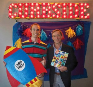 Owen professor Jim Schorr (right), who teaches social entrepreneurship classes at Peabody, traveled to  Oklahoma City for the grand opening of Whitley O'Connor's Curbside Chronicle venture.
