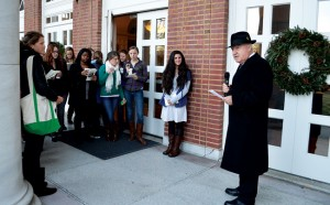 James Hogge (right), associate dean and professor, emeritus, leads students in Peabody's annual Hanging of the Green at the Wyatt Center on December 1.