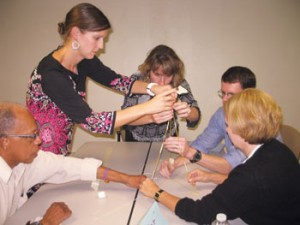 One activity used by the Principals Leadership Academy of Nashville is to have participants build a structure using specific rules. Given noodles, marshmallows, string and tape with which to build, participants use collective perspective and adaptive expertise to understand the directions and anticipate consequences before they build the structure. Most structures ultimately collapse under the weight of the marshmallows, because not enough attention is paid to building a supportive foundation.