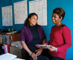 "Teaching and Learning in Urban Schools Director and Assistant Professor of the Practice Lanette Waddell (left) with TLUS student Kelly Aldridge, who teaches seventh grade math at Wright Middle School. Waddell says, ""I'm always in the schools. I get to see teachers teach, and then go back and think about what I saw. It really pushes my thinking and research. It's a great mix of practice and theory."""