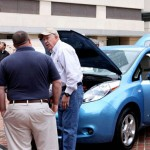 Many employees were eager to check out the look and feel of the new, no emission, electric vehicle, the Nissan Leaf. Owner David Lifferth was happy to show it off. (Vanderbilt University/Susan Urmy)