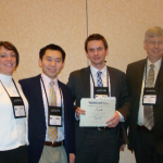Carol Callaway-Lane, Irving Ye, and Piotr Pilarski receive award from Duncan Neuhaser (right)