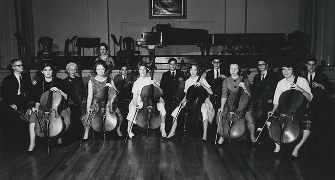 Group of musicians, mostly cellists. Historical photo.