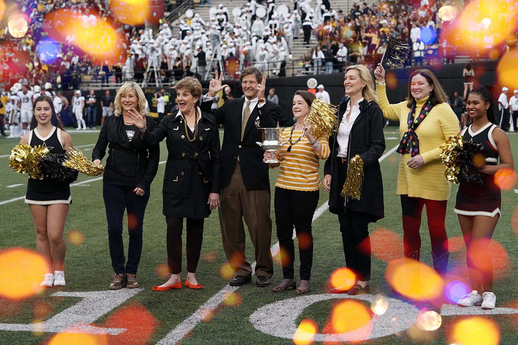 Photo of alumni at football game