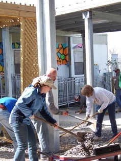 TP students (Anna Lee, Steve Mason and Debra Neal) clear rocks from schoolyard